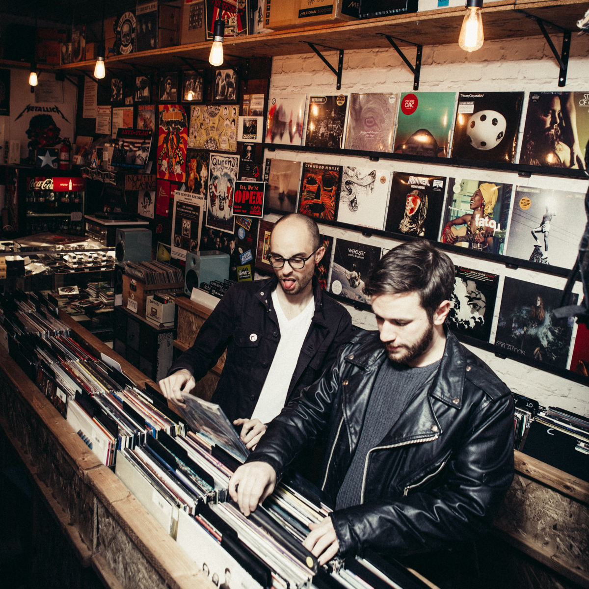Evan Barden and Pat Cartelli digging through the crates at a record store